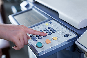 person using multifunction printer