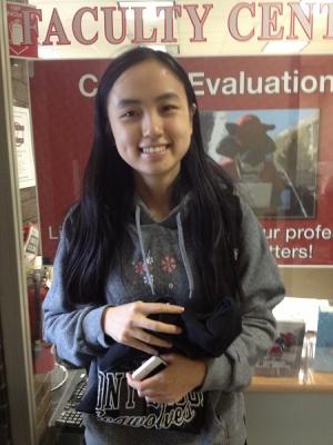 Student holding stony brook shirt